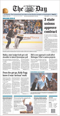 The Day, of New London, Conn., used a photo of a cameraman chasing Tim Thomas with the Cup and a small headline, 'BRUINS RULE.'