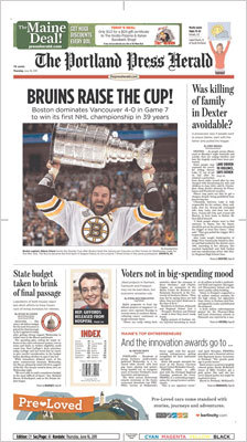 The Portland Press Herald used a straight-on photo of Zdeno Chara yelling while holding the Cup with a headline 'BRUINS RAISE THE CUP!'