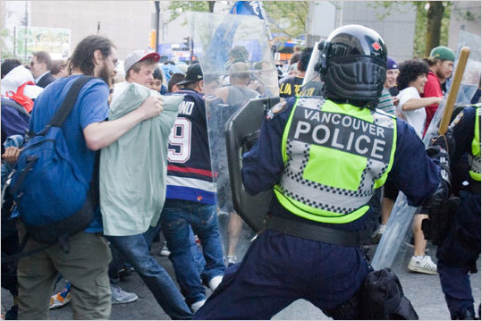 Police clashed with people on the street following Game 7 in Vancouver.