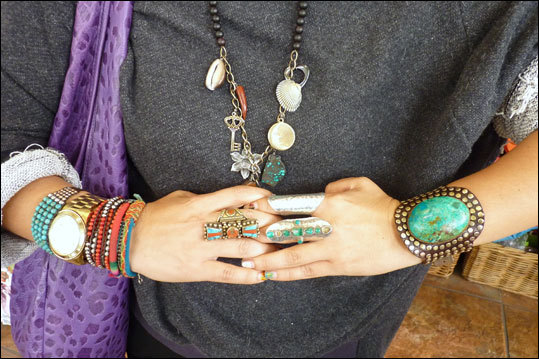 Co-owner Pamela Vilchez models her jewelry designs at Kukuly's 915- 11 Santee St. Almost everything in the store in handmade in Peru.
