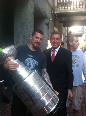 Bruins defenseman Andrew Ference posed with George Regan, president of Regan Communications, and the Stanley Cup.