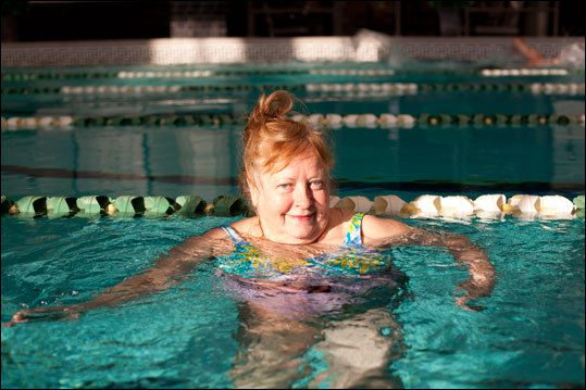 Donna Harnsberger takes an afternoon swim in the 6th floor swimming pool at the 125-year old Los Angeles Athletic Club.
