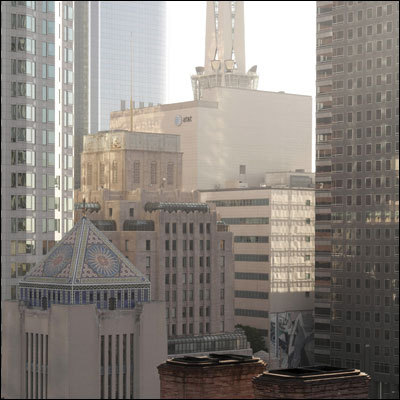 A view of downtown from the roof of the Los Angeles Athletic club. The tiled mosaic pyramid in the foreground is the roof of the Richard Riordan Central Library.
