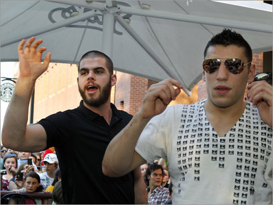 Bruins Nathan Horton (left) and Milan Lucic bade farewell to fans who flocked to Tia's Restaurant, where some Bruins brought the Stanley Cup after arriving back in Boston on Thursday.