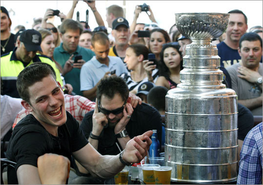 Bruins center Tyler Seguin laughed as he sat with teammates and the Stanley Cup at Tia's Restaurant in Boston.