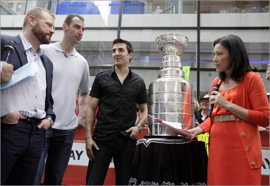 Bruins leaders Tim Thomas, Zdeno Chara and Patrice Bergeron, left to right, are interviewed by NBC 'Today' television program co-host Ann Curry during an appearance with the Stanley Cup on the show in New York on June 17.