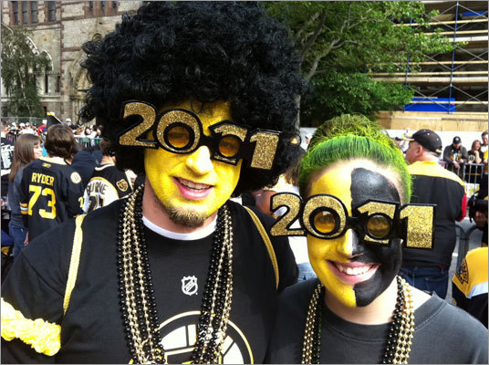Mark Morin, 22, from Attleboro and his girlfriend, Colleen Casey, 22, from North Attleboro showed their team spirit as they awaited the start of the Bruins rolling rally through the streets of Boston.