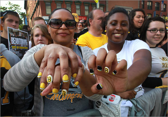 Annie Williams (left) and her daughter, Valerie Williams, both of North Andover, showed off their Boston Bruins inspired painted fingernails.