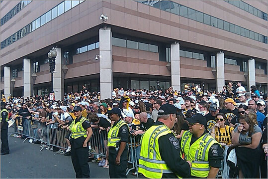 Police kept fans behind barriers along the parade route.