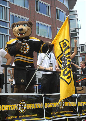 Blade, the mascot of the Bruins, waved a Bruins flag at the Stanley Cup victory parade.