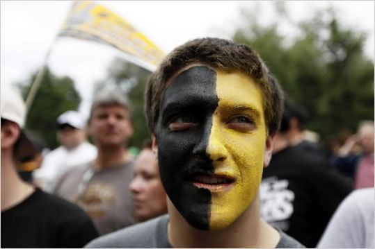 Benjamin Witunsky of Quincy painted his face black and gold, and took a Red Line train to the parade.