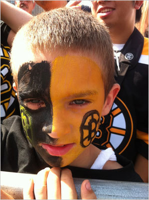 This young fan in the front row had his face painted black and yellow with spoked-B's on each cheek.