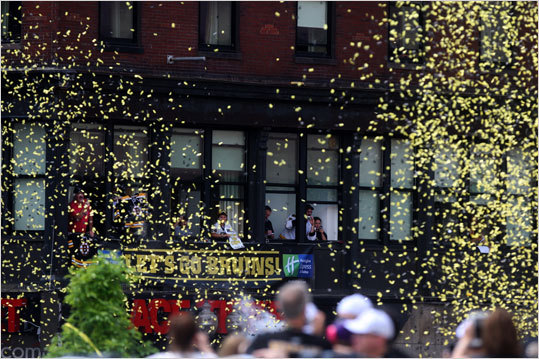 Confetti fluttered in the air during the Bruins' rolling rally parade on Causeway Street.