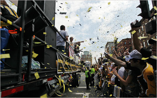 Confetti flew over a joyful crowd Saturday during the Boston Bruins Stanley Cup parade in Boston. The parade began at the TD Garden and ended at Copley Square.