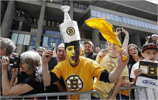 Bruins' fans celebrated during the rolling parade in Boston.