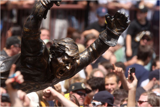 The Bruins rolling rally parade rolled past the famous Bobby Orr statue at TD Garden.