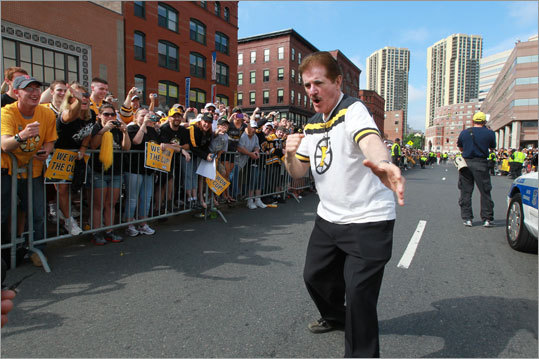 Rene Rancourt, who sings the national anthem, as well as 'O, Canada,' when Canadian teams are in town, worked the crowd with his signature fist pump prior to getting on a duck boat.