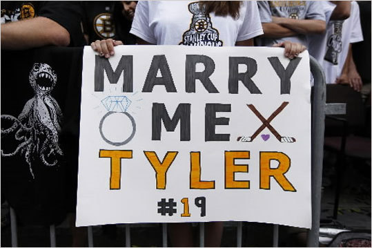 Kaleigh Gagnon, 18, of Attleboro held a sign asking Bruins rookie Tyler Seguin to marry her.