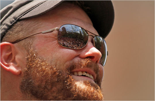 The crowd can be seen in the reflection of Tim Thomas's sunglasses.