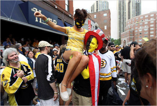 Chris Cole held Dominika Bzdula as they and other Bruins fans celebrated the team's Stanley Cup victory.