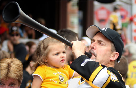 Ken Lamport with his granddaughter Abbos Lamport at the Bruins' parade.