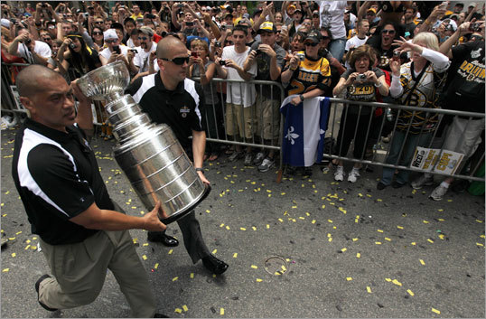 Chara wasn't the only Bruin who got to hold the Cup during the parade. Bruins staff members ferried the trophy to other duck boats to give other players a chance to roll with it.