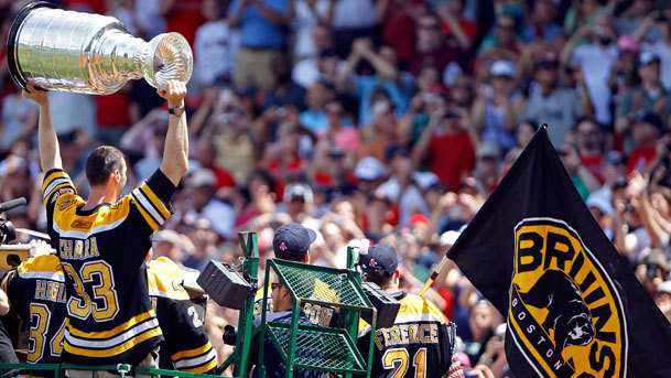 The Red Sox honored the Stanley Cup champion Bruins on Sunday afternoon with a pregame ceremony at Fenway Park. During the ceremony, Bruins captain Zdeno Chara (left) held the Cup as he and his teammates rode in on duck boats.