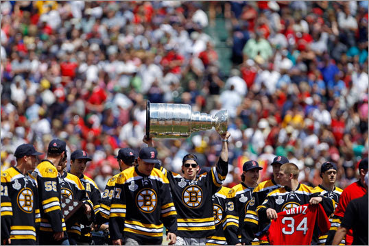 The Bruins' youngest player, Tyler Seguin, held up the Cup just before Bruins players threw out ceremonial first pitches.