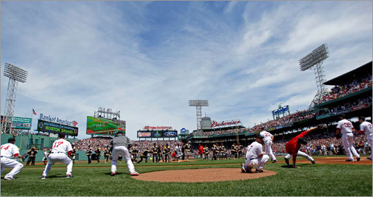 Red Sox players caught ceremonial first pitch throws from each Bruins player before the game.