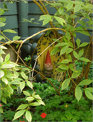 "Tom Cobb's garden is a ""welcome habitat for bees"" and features a gnome that keeps watch over the flowers."