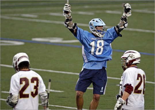 "Medfield pours it on Division 2 state boys' lacrosse final: The Medfield Warriors netted four goals in the fourth quarter to sink Algonquin, 13-9, at Foley Stadium in Worcester, last Friday. ""It's a game of runs, and no one is going to play a perfect game,' Medfield coach Bob Aronson said. 'We tried to capitalize in the second half, and in the fourth quarter particular we did that a lot.'' Story: Medfield 13, Algonquin 9"