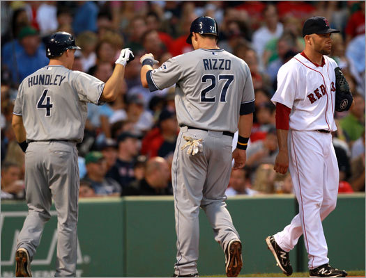 June 21: Padres 5, Red Sox 4 Padres catcher Nick Hundley (left) congratulated teammate Anthony Rizzo after Rizzo scored in the third inning off Red Sox starter Alfredo Aceves. Aceves gave up four runs in five innings, walking six batters in the process.