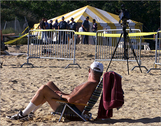 Tenean Beach, Dorchester In September 2000, investigators trudged over to Tenean Beach to dig up the remains of Paul McGonagle, a rival of Bulger who disappeared in 1974. His body had been buried in a grassy area at the edge of the beach alongside the Southeast Expressway, less than a mile from where three other murder victims were unearthed on Hallet Street near Florian Hall. At left, Gary Hillis of Dorchester enjoyed the beach while search efforts went on under the tent for bodies found on the beach in 2000.
