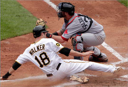 June 26: Red Sox 4, Pirates 2 Pittsburgh's Neil Walker (18) scored from third on a sacrifice fly to center field by Ronnie Cedeno.