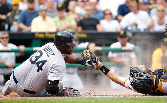 June 26: Red Sox 4, Pirates 2 David Ortiz slid safely past Eric Fryer to score the second of two runs in the seventh inning that put the Red Sox up, 4-2.