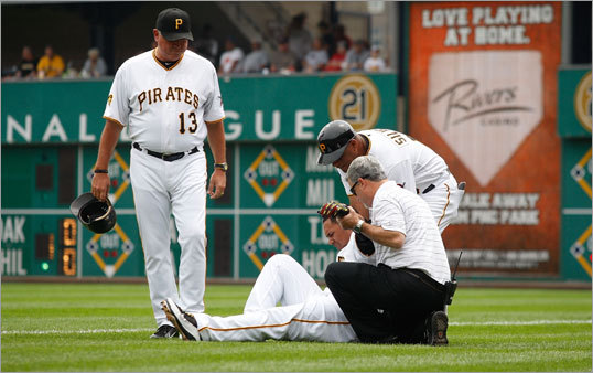 June 26: Red Sox 4, Pirates 2 Pittsburgh Pirates manager Clint Hurdle (left) looked on as Pirates outfielder Jose Tabata was attended to after injuring himself running to first base on a bunt. Tabata was carted off the field and did not return to the game.