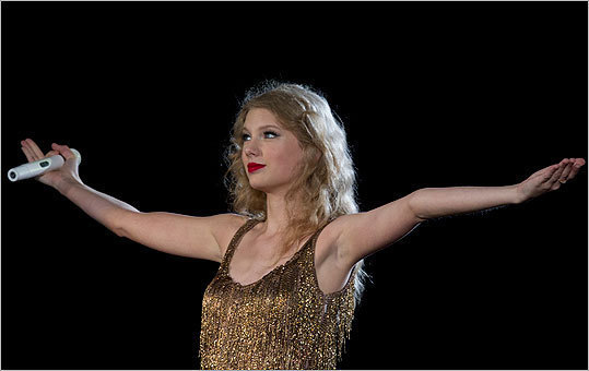 It was good to see Swift humbled by an unscripted turn of events. Her stage persona continues to feel both endearing and grating. With her moony looks of disbelief and long pauses to scare up more wild applause, it&#146;s now hard to stomach her brand of understatement. This is, after all, a fully formed pop star who struts in perpetual freeze-frame poses, long blond locks swinging in synch. Read James Reed's review.