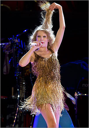 "Amid the uplifting love songs (""Sparks Fly,"" ""You Belong With Me"") and sassy kiss-offs (""Better Than Revenge,"" ""Speak Now""), this tour manages to downplay some of the stadium bombast for a more down-home feel. With a banjo slung over her shoulder, Swift led a cozy, back-porch rendition of ""Mean."" On piano, she was subtle and poised for ""Back to December."" Likewise, Swift perched on a little island far from the stage to strum a ukulele on ""Fearless"" and then an acoustic guitar for ""Last Kiss."" Read James Reed's review."
