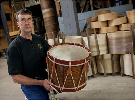 Jay Jones, 57, pictured here, is the president of Noble & Cooley and a sixth generation drum maker, a direct descendant of the company's founder, James P. Cooley. Despite struggling through fires, the Great Depression, World War II, and the holiday season following 9/11, all of which have put the company at risk, it still continues to make drums of all kinds, such as replicated snare drums, and even at one point made drum kits for some of the world's top musicians.