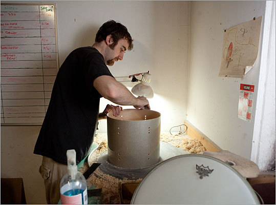 Here, Nick Jones sands a red oak shell for a drum. He is a musician too. He plays the bass in a band with older brother Jonathan, who is the real family drummer.