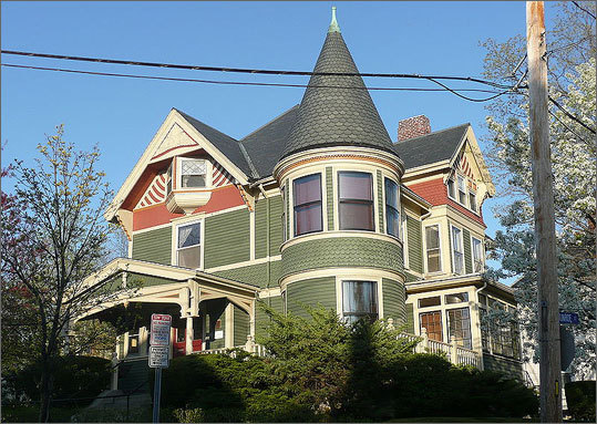 Louville Niles House 45 Walnut St. A example of Queen Anne style, the home was built in 1890 and includes hallmarks of the that type of design: turrets, stained glass, and patterned shingles.