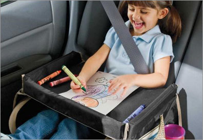 A stable space for a mobile child StarKids' Deluxe Snack and Play travel tray makes road trips more fun: It has a surface that's solid enough to hold coloring books, small toys, snacks, and lunch, and a 2-inch-high rim that keeps everything from running away. The crash-tested, foam-filled nylon tray also safely collapses in an accident. It measures 16 inches wide by 14 inches deep, and works great on a stroller, an airplane, and at the beach. Machine-washable, it has a waist strap that wraps around your child, two side pouches for stashing snacks and toys, and two pockets that are big enough to swallow most sippy cups. It sells for $19.95 through One Step Ahead (800-274-8440, www.onestepahead.com ), or contact StarKids Products (303-887-9017, www.starkidsproducts.com ). KARI BODNARCHUK