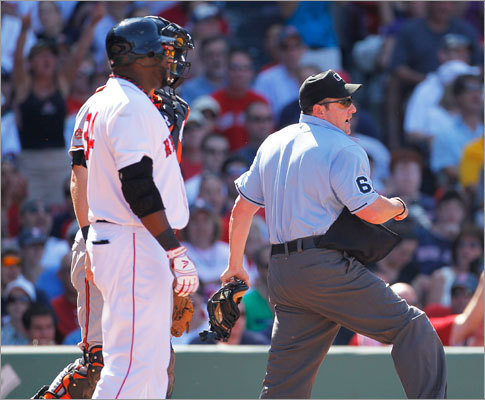 July 10: Red Sox 8, Orioles 6 Baltimore's relief pitcher Michael Gonzalez (not pictured) was thrown out by umpire Marty Foster after Gonzalez threw a pitch behind Red Sox DH David Ortiz (left) in the bottom of the 6th inning.