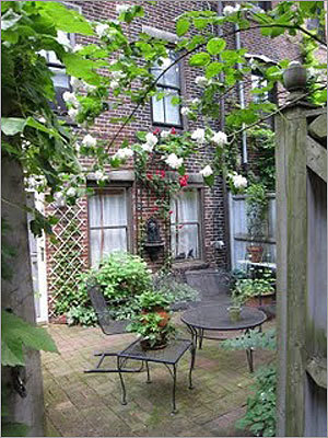 Gray Street: Residents who face the alley help to maintain this secret garden behind this street.