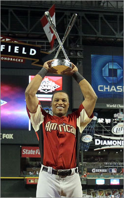Robinson Cano hoisted the Home Run Derby trophy after slugging a record 12 homers in the final round, ousting Adrian Gonzalez by 1. Cano's father, Jose, threw every pitch to his son, including one which turned into a 472-foot homer off the Miller Lite sign. 'I don't want to say that I won the trophy,' Robinson Cano said. 'I want to say that my dad has won the trophy.'