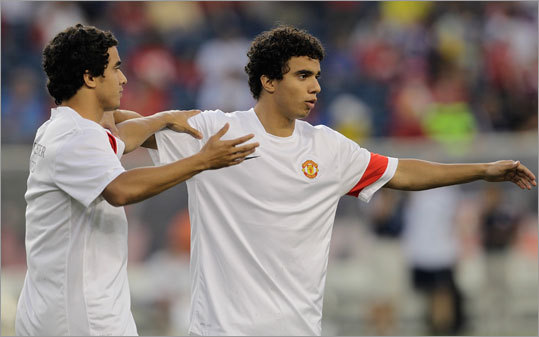 Fabio and Rafael stretched before their friendly match against the New England Revolution.