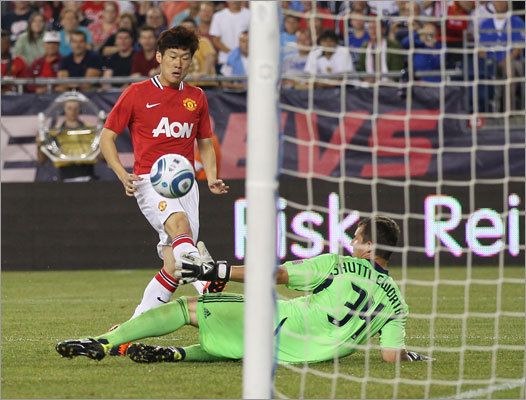 Ji-Sung Park capped the scoring for Manchester United, beating Revolution goalie Bobby Shuttleworth late in the second half to make it 4-1.
