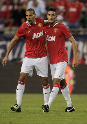 Federico Macheda scored twice for Manchester United, and celebrated with teammate Rio Ferdinand after one of them.