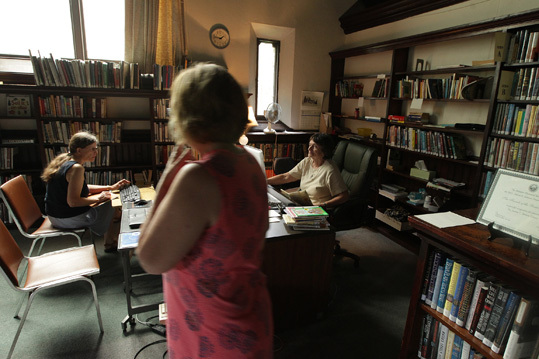 The volunteer librarians see themselves as temporary stewards of the buildings and books. They hope that their communities will find enough money to once again run the libraries with paid staff and longer hours. From left, Jocely Record, library president Elizabeth Gibson, and Beth Corwin at work in the Benton Library.
