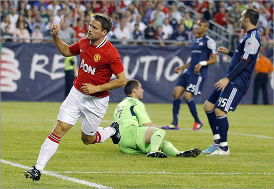 Michael Owen scored the first of four second-half goals for Manchester United, which easily won its exhibition match against the New England Revolution at Gillette Stadium in Foxborough. United defeated the Revs 4-1 in the first game of a five-game American tour.